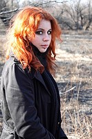 red haired girl outdoors torso