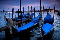 Gondolas in front of San Giorgio Maggiore Venice Veneto Italy.