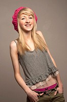 A slim blonde 14 year old teenage girl with dental braces on her teeth, UK
