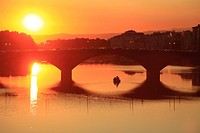 Ponte alle Grazie over Arno river at sunset, Florence, Tuscany, Italy
