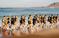 Spanish soldiers running on Las Canteras beach in Las Palmas, Gran Canaria, Canary Islands