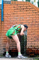 Athletics Athlete drinking water in a competition of the Madrid athletics