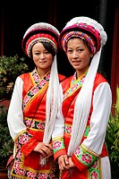 Two girls from Bai Ethnic group dressed in traditional costumes (Bai is one of the 56 ethnic groups officially recognized by the Chinese government), ...