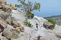 Woman jogging on trail in hills, Santa Fe, New Mexico, USA