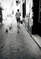 Man walking dogs. Ciutadella, Minorca, Balearic Islands, Spain