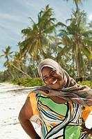 Local woman on beach on Zanzibar Island.