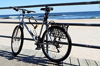 An old bicycle tied up on the boardwalk in Asbury Park, New Jersey, USA