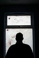 man sitting in dark room