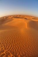 Africa, Tunisia, nr  Ksar Rhilane  Sunrise over Ksar Ghilane in the sand dunes on the eastern edge of the Grand Erg Oriental in the Sahara desert