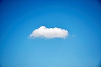 Single cumulus cloud in the sky