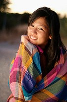 Cute young asian woman at sunset