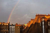 Rainbow on the london buildings in the afternoon