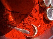 Red pigment pile with silver mirror boxes and silver spoon in Rishikesh, Uttarkhand, India