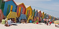Rows of wooden huts/bathing boxes/private changing room line the high water mark at Muizenberg Beach, Cape Town, South Africa