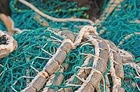 Pacific herring purse seine net and lead line on stack on fishing boat in Sitka, Alaska.
