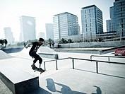 Skater jumping. Avinguda Litoral, Fòrum, Diagonal Mar district. Barcelona, Catalonia, Spain.