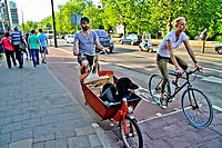 Amsterdam, couple and dog in bycicles