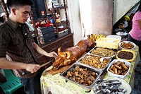 Traditional food on offer during a baptism party at a filipino family house  Lapu-Lapu City, Metro Cebu, Mactan Island, Visayas, Philippines