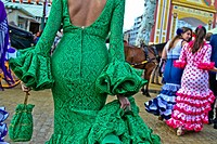 A Woman wearing flamenco dress at the April Fair in Seville, Spain