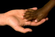 White woman´s hand receive the black child´s hand