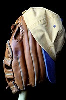 Wait till next year  A baseball glove and cap sitting on a wooden bat