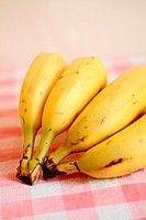 Bananas on red gingham cloth