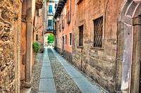 Old colorful stone alley in orta italy
