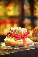 Kougelhopf, famous alsatian yeast ring cake, at the ´Maison Alsacienne de biscuiterie´ display window  Colmar  France