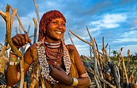 Turmi Ethiopia Africa Lower Omo Valley village with Bena Tribe First Wife smiling in sunset in wood hut village 24