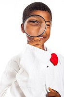Happy clever scientist school boy with magnifying glass, isolated on white background
