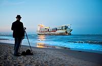Spain, Valencia, El Saler, Photographer and Boat on Beach