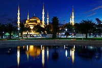 Blue Mosque lit at dusk with reflection in fountain Istanbul Turkey