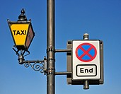 London, England, UK. Taxi lamp and traffic sign outside the Houses of Parliament