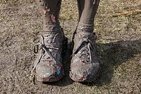 Pair of muddy training shoes after the owner has run a cross country race