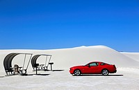 A red car with shaded picnic tables in the picnic area in White Sands National Monument. Alamogordo. New Mexico. USA.