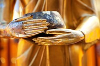 Closeup of a golden Buddha hands holding a cup in Doi Phrathat Suthep temple. Doi Suthep is located 15 Km from Chiang Mai Thailand on a top of a mount...