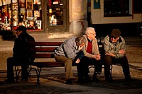 Three old men talking