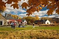 Golfers tee off, Millbrook golf resort, autumn between Arrowtown and Queenstown, Otago, New Zealand.