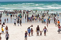 On a public holiday, people stream to the beach. A hot summer's day in Cape Town, South Africa