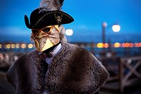 A man wearing a costume during the Venice Carnival, Venice, Italy.