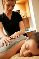 Young woman relaxing and having a massage.
