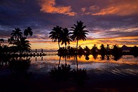 FRENCH POLYNESIA, SOCIETY ISLANDS, TAHITI, BEACHCOMBER HOTEL, SUNSET REFLECTING IN POOL.