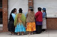 Women standing in circle, La Paz, Bolivia.
