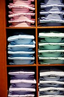 Stacks of Men´s Dress Shirts Displalyed in a Retail Store.