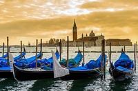 Europe, Italy, Veneto, Venice, classified as World Heritage by UNESCO. Gondola and the church San Giorgio Maggiore at sunset.