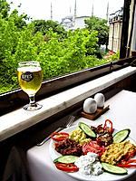 Turkish Cuisine. Meze and Efes Beer. Omar Restaurant, Sultanahmet, Istanbul, Turkey.
