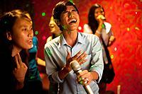 University students enjoy a night in a karaoke bar in Phnom Penh, Cambodia.