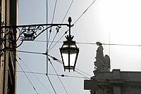 Streetlamp. In the background, the top of the Arco do Triunfo. Baixa, Lisbon, Portugal.