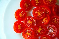 Cherry tomatoes on a dish. Close view.