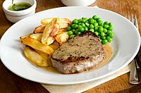 Steak, chips, peas and quick peppercorn sauce.